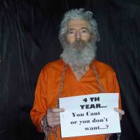 Proof of life: The family of retired FBI agent Robert Levinson, who disappeared on the Iranian island of Kish in March 2007, received these photographs of him in April 2011.   AP
