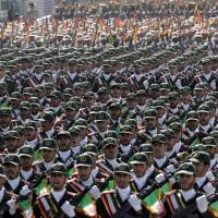 Lines of force: Troops from Iran's Revolutionary Guard march during a military parade commemorating the start of the Iraq-Iran War, in front of the mausoleum of late revolutionary leader Ayatollah Ruholla Khomeini, just outside Tehran, in September 2012. | AP