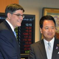 Brass tacks: U.S. Treasury Secretary Jack Lew is greeted by Akira Amari, minister in charge of Japan's Trans-Pacific Partnership talks, before their Tuesday meeting in Tokyo | AFP-JIJI