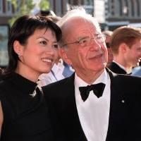 Should have known: Media magnate Rupert Murdoch and his wife, Wendi Deng, who recently agreed on a divorce settlement, arrive for the official opening of Fox Studios Australia in Sydney in November 1999. | AFP-JIJI