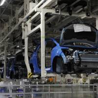 Fitting in: Honda Motor Co. Fit cars head down the assembly line at the firm's Saitama Prefecture plant in November. | BLOOMBERG