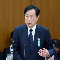 Bullish: Yasuhiro Sato, president of Mizuho Financial Group Inc., appears before Lower House Financial Affairs Committee on Wednesday. | BLOOMBERG