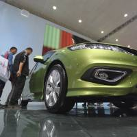 A gem: Visitors view a Honda Jade at the booth of Dongfeng Honda Automobile Co. the joint venture between Dongfeng Motor Corp. and Honda Motor Co., at the Wuhan Motor Show 2013 in Wuhan, central China, on Oct. 19 | BLOOMBERG