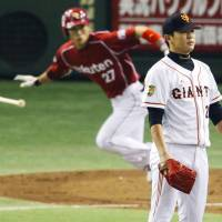 Take it on the chin: Giants pitcher Tetsuya Utsumi watches Takero Okajima's third-inning hit in Game 5 of the Japan Series on Thursday night. | KYODO