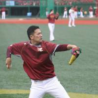 Striving for perfection: Tohoku Rakuten pitcher Masahiro Tanaka works out with teammates at Kleenex Stadium in Sendai on Friday ahead of Game 6 of the Japan Series. | KYODO