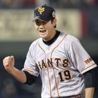 Stellar effort: Giants starter Tomoyuki Sugano tosses seven innings of two-run ball in Game 6 to earn the win. | KYODO
