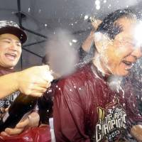 How sweet it is: Eagles pitcher Masahiro Tanaka (left) sprays manager Senichi Hoshino with beer as Rakuten celebrates its first Japan Series title on Sunday. | KYODO