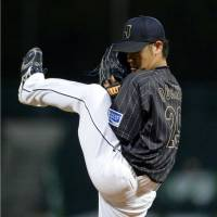 Leg up on the competition: Japan's Yasuhiro Ogawa pitches against Taiwan on Friday. | KYODO
