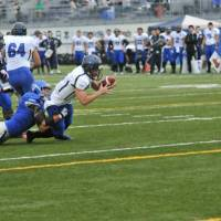 Reaching out: Panasonic backup quarterback Yuma Nakashima  extends his arms to get in the end zone for a 3-yard rushing touchdown  in the fourth quarter of an X League game on Saturday. Panasonic defeated IBM 55-24. | HIROSHI IKEZAWA