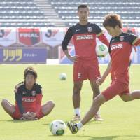 Red dawn: Urawa Reds forward Genki Haraguchi takes a shot in front of teammates during a training session on Friday ahead of Saturday's Nabisco Cup final at National Stadium.   KYODO