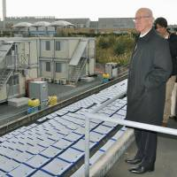 Fork in the road: Manchester United legend Bobby Charlton surveys the J-Village facilities — now being used to aid efforts to deal with the nuclear crisis at the nearby Fukushima Daiichi nuclear power plant — in Fukushima on Monday. | KYODO