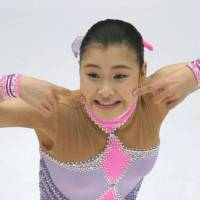 Say cheese: Kanako Murakami performs her short program routine at the Cup of China in Beijing on Friday night. | KYODO