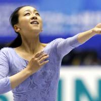 Finishing touch: Mao Asada practices for the NHK Trophy on Thursday. | KYODO