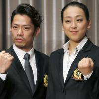 Go for gold: Mao Asada and Daisuke Takahashi pose during a news conference on Thursday. | KYODO