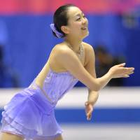 Joyful performance: Mao Asada skates during the women's short program at the NHK Trophy on Friday at Yoyogi National Gymnasium. Mao sits in first place with 71.26 points. | AFP-JIJI