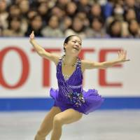 Graceful presence: Akiko Suzuki earns 66.03 points for her short program routine at the NHK Trophy on Friday, putting her in second place behind Mao Asada. | AFP-JIJI