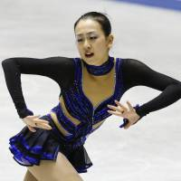 Building momentum: Mao Asada performs her free-skate routine at the NHK Trophy in Tokyo on Saturday. Mao won the competition and qualified for the Grand Prix Final. | KYODO