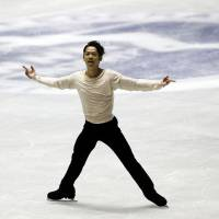 Twist and shout: Daisuke Takahashi performs his free-skate routine en route to overall victory at the NHK Trophy on Saturday. | AP