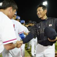 Watching and waiting: Japan manager Hiroki Kokubo has been tasked with putting the team in position to reclaim the World Baseball Classic title in 2017. | KYODO