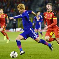 Building momentum: Yoichiro Kakitani moves the ball ahead of Belgium's Toby Alderweireld in a friendly international Tuesday. | AFP-JIJI