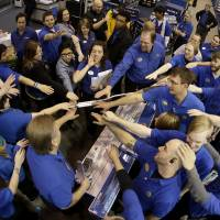Those about to sell, salute: Best Buy employees rally after a pep talk as they prepare to open the store Thursday in Overland Park, Kansas. Instead of waiting for Black Friday, which is typically the year's biggest shopping day, more than a dozen major retailers opened on Thanksgiving this year.   AP