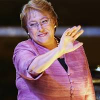 Running on: former Chile President Michelle Bachelet waves after speaking to supporters after general elections in Santiago on Sunday. Bachelet won nearly twice as many votes as her closest rival in the nation's presidential election, but she fell short of the outright majority needed to avoid a Dec. 15 runoff. | AP
