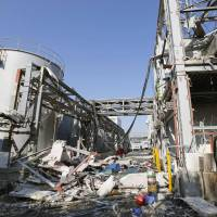 Torched: The remnants of an oil recycling factory stand early Saturday after an explosion tore through the site, killing two people in Noda, Chiba Prefecture, a day earlier. | KYODO
