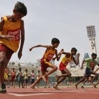 Generation slowpoke: Boys participate in a 100 meter race during the two-day World Athletics Day meet in Bangalore, India, in May 2007. An analysis of studies on 250 million children around the world has found that don't run as fast or as far as their parents did when they were young.  Research featured at the American Heart Association's annual conference on Tuesday showed that on average, children 9 to 17 take 90 seconds longer to run a 1.6 km than their counterparts did 30 years ago | AP