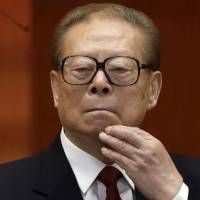 Wanted man: Former Chinese President Jiang Zemin takes part in the opening session of the 18th Communist Party Congress at Beijing's Great Hall of the People in November 2012. Spain's National Court has issued arrest orders for former Chinese leader and four other officials as part of a probe into alleged genocide by China against Tibet, it said Tuesday | AP
