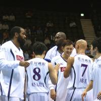 Life or death: Levanga Hokkaido's Takehiko Orimo (smiling, center) believes every club in the NBL must try to attract fans as if their survival depends on it | KAZ NAGATSUKA