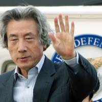 Right to change: Junichiro Koizumi waves as he departs Tokyo's Haneda airport in September 2006 on a trip as prime minister. On Sunday, he defended his anti-nuclear shift, urging the government to scrap its goal of restarting reactors | BLOOMBERG