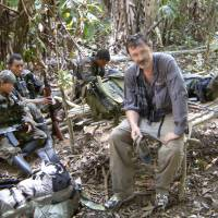 Casting a Net: Adventurer Robert Young Pelton sits in the presence of United Self-Defense Forces of Colombia (AUC) paramilitary members during a 2003 crossing of the Darien Gap, which separates Panama and Colombia. Pelton, whose crowd-funding plan has already drawn criticism from a pair of Africa experts, is the latest to join a line of private individuals and aid groups who are trying to corner Joseph Kony and the members of his Lord's Resistance Army | AP