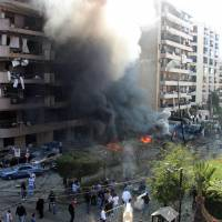 Inflamed tensions: Flames rise from the site of two blasts in Beirut on Tuesday. At least 23 people were killed in the bombings outside the Iranian Embassy in Lebanon's capital, including cultural advisor from Tehran, government sources said | AFP-JIJI