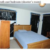 Dark omen: Black trash bags are seen taped over the windows of a room in the Newtown, Connecticut, home where Sandy Hook gunman Adam Lanza lived with his mother in an image released Monday with a report on the mass shooting. | AP