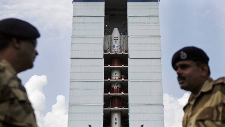 Mars beckons: Central Industrial Security Force personnel stand guard near the Polar Satellite Launch Vehicle at the Satish Dhawan Space Center at Sriharikota, India, on Oct. 30. India is aiming to join the world's deep-space pioneers with a journey to Mars that it hopes will showcase its technological ability to explore the solar system while seeking solutions for everyday problems on Earth
