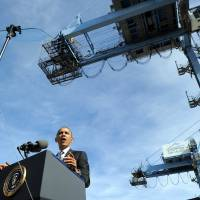 Pep talk: U.S. President Barack Obama speaks at the Port of New Orleans in Louisiana on Friday. Obama arrived in the city to discuss the importance of taking measures to grow the economy and create jobs by increasing U.S. exports. | AFP-JIJI