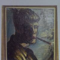 Uncovered: A painting by Otto Dix entitled 'Selbstportrait Rauchend' ('Selfportrait Smoking') is projected on a screen during a news conference in Augsburg, Germany, on Tuesday. The painting is part of a hoard of more than 1,400 pieces found last year at a Munich apartment that includes previously unknown pieces | AP