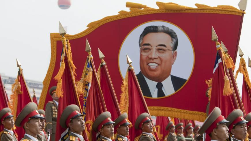 Marching on: Members of the North Korean military march past a portrait of Kim Il Sung during a parade commemorating the 65th anniversary of the Korea Worker's Party in Pyongyang in October 2010