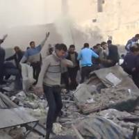 Seeking survivors: In this image taken Saturday from a video obtained from the Sham News Network, which is consistent with independent AP reporting, people look for survivors in the aftermath of a government airstrike in Aleppo, Syria. | AP