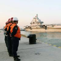 The long game: China's sole aircraft carrier, the Liaoning, departs the northern port city of Qingdao for its first-ever sea trials in the South China Sea on Tuesday, a mission likely to draw scrutiny amid Beijing's drive to assert its claims to those waters and their island groups. | KYODO