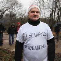 Freed: Belarusian opposition activist Leonid Smovzh wears a T-shirt with a sign reading, 'For Belarus without Lukashenko,' during a protest against President Alexander Lukashenko in Minsk on Nov. 10. The 53-year-old railroad engineer, who was arrested for wearing the T-shirt, has been freed after five days in jail | AP