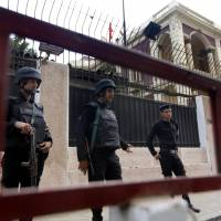 'Drifting alone in a vacuum': Egyptian policemen guard the Turkish Embassy in Cairo on Saturday.  Egypt downgraded diplomatic relations with Turkey and expelled its ambassador from Cairo on Saturday, a sharp escalation in tensions between the two countries that mounted after a military coup ousted the country's Islamist president this summer. | AP