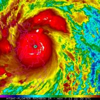 Red menace: This satellite image from the U.S. National Oceanic and Atmospheric Administration shows Typhoon Haiyan over the Philippines on Friday. With sustained winds of 235 kph and gusts of up to 275 kph, it is one of the most powerful ever recorded. Haiyan set off landslides, knocked out power and communications and forced the evacuation of 720,000 people.  | AP