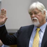 In the dock: Anti-whaling activist Paul Watson, founder of the Oregon-based Sea Shepherd Conservation Society, is sworn in before testifying during a contempt of court hearing in federal court in Seattle on Wednesday   AP