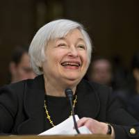 Money in the bank: Janet Yellen, President Obama's nominee to succeed Ben Bernanke as Federal Reserve chairman, smiles as she finishes testifying at her confirmation hearing before the Senate Banking Committee on Capitol Hill in Washington. | AP
