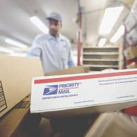 USPS revenue up but losses linger as overhaul bill appears to stall