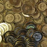 Bitcoins now valued at more than $1,000 each