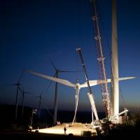 Out of fin air: Workers in Caetite, Brazil, prepare blades to be hoisted onto a tower at the High Wilderness Wind Complex, a project of more than 400 wind turbines run by Renova Energia, a Sao Paulo energy company, on Oct. 25 | THE WASHINGTON POST