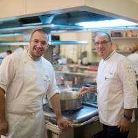 Well done: Bernard Vaussion (right), retiring head chef at the Elysee Palace, poses with his successor, Guillaume Gomez, on Thursday in the kitchens at the palace in Paris | AP