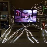 Game of shadows: The IllumiRoom project, a proof-of-concept system combining a projector and sensor to project visualizations and augment areas surrounding a TV screen, is seen in am image released by Microsoft. Augmented reality was among the topics discussed at the Game Developers Conference Next at the Los Angeles Convention Center on Nov. 5-7 | AP